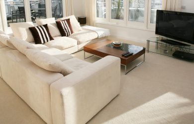 an image of a carpet in a living room with a sofa and tv