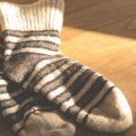 an image of socks on wooden flooring