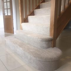 an image of a staircase fitted with carpet