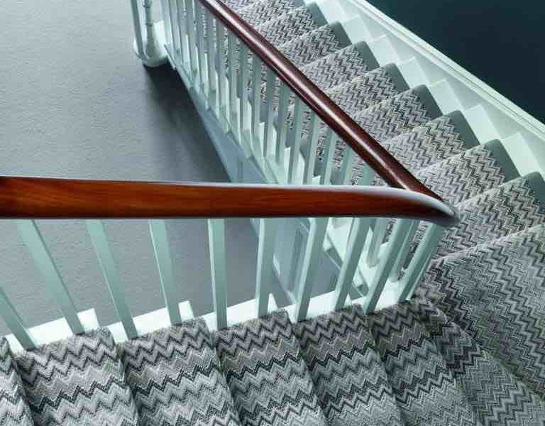 an image of a staircase with carpet