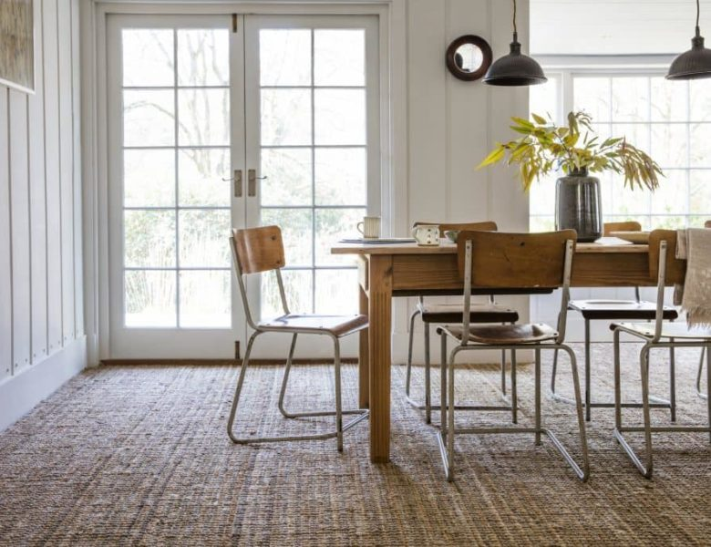 An image of a dining room with natural flooring