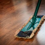 An image of a microfibre mop on a wooden floor